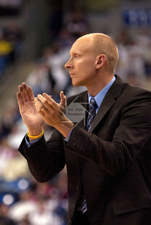 February 24,  2010                Xavier head coach Chris Mack applauds for his team in the second half.   The St. Louis University Billikens hosted the Xavier University Musketeers on Wednesday February 24, 2010 at the Chaifetz Arena, located on the campus of St. Louis University near downtown St. Louis.  Xavier ended Saint Louis' six-game winning streak, with a final score of 73-71.