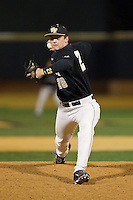 Wake Forest Demon Deacons relief pitcher Garrett Kelly (28) delivers a pitch to the plate against the Georgetown Hoyas at Wake Forest Baseball Park on February 16, 2014 in Winston-Salem, North Carolina.  The Demon Deacons defeated the Hoyas 3-2.  (Brian Westerholt/Four Seam Images)