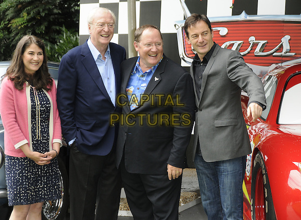 Denise Ream (producer), Sir MIchael Caine, John Lasseter (director) & Jason Isaacs.UK Premiere of 'Cars 2' at Whitehall Gardens,  London, England..July 17th 2011.half length blue pink black print dress jacket suit shirt hand arm smiling grey gray shirt glasses .CAP/CAN.©Can Nguyen/Capital Pictures.
