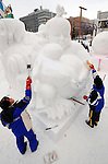 Participants from different countries craft ice sculptures during the snow and ice festival in Sapporo City, northern Japan. About 2 million people visit the city to see the hundreds of hand-crafted snow and ice sculptures that have graced the Sapporo Snow Festival since its inception in 1950.