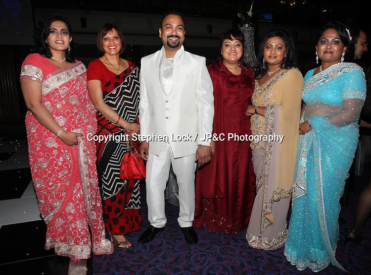 Lycamobile Chairman Subas Allirajah and his wife Prema (2nd right) with some of his guests at his 40th birthday party held in London, Friday, 2nd March 2012.  Photo by: Stephen Lock / i-Images