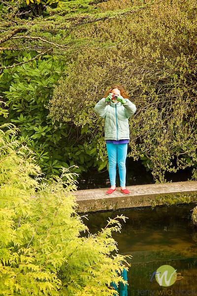 Kubota Garden, Seattle, WA. Ellie with camera on walk bridge.