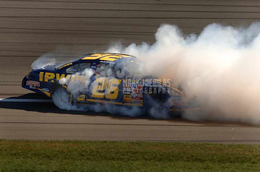 Oct 1, 2006; Kansas City, KS, USA; Nascar Nextel Cup driver Jamie McMurray (26) spins during the Banquet 400 at Kansas Speedway. Mandatory Credit: Mark J. Rebilas