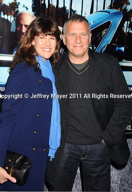 "HOLLYWOOD, CA - MARCH 22: Paul Reiser and wife Paula Ravets attend HBO's ""His Way"" Los Angeles Premiere at Paramount Theater on the Paramount Studios lot on March 22, 2011 in Hollywood, California."