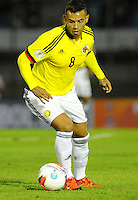 MONTEVIDEO - URUGUAY -13-10-2015: Edwin Cardona, jugador de Colombia, durante partido entre Uruguay y Colombia de la fecha 2 por la clasificación a la Copa Mundo FIFA 2018 Rusia jugado en el estadio Centenario de la ciudad de Montevideo. /  Edwin Cardona, player of Colombia, during match between Uruguay and Colombia, for the date 2 for the 2018 FIFA World Cup Russia Qualifier played at Centenario Stadium in Montevideo city. Photo: Photosport / VizzorImage / Dante Fernandez / Cont.
