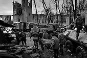 Grozny, Chechyna.January 1995.In a front line hospital/morg four dead Rusian soldiers are unloaded from an APC after they were killed by a Chechen mortar at the front.