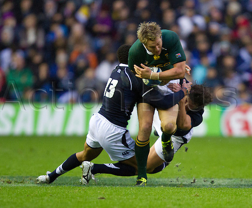 20.11.2010 International Rugby Union from Murrayfield Scotland v South Africa..South Africas 13 Frans Steyn is tackled by two scotland backs.
