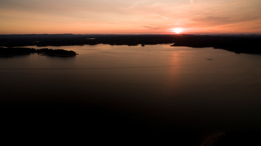The sun sets on Lake Ouachita, Arkansas on Thursday, Sept. 7, 2017, in Arkansas. (Photo by James Brosher)