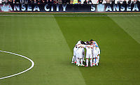 SWANSEA, WALES - FEBRUARY 21: Swansea players huddle prior to the Barclays Premier League match between Swansea City and Manchester United at Liberty Stadium on February 21, 2015 in Swansea, Wales.