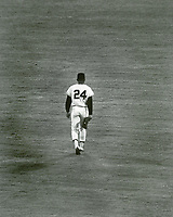 Willie Mays walks to his position in center field. This was Willie's last game with the San Francisco Giants<br />