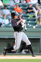 Outfielder Adam Engel (23) of the Kannapolis Intimidators bats in a game against the Greenville Drive on Friday, April 11, 2014, at Fluor Field at the West End in Greenville, South Carolina. Engel is the No. 22 prospect of the Chicago White Sox, according to Baseball America.  (Tom Priddy/Four Seam Images)