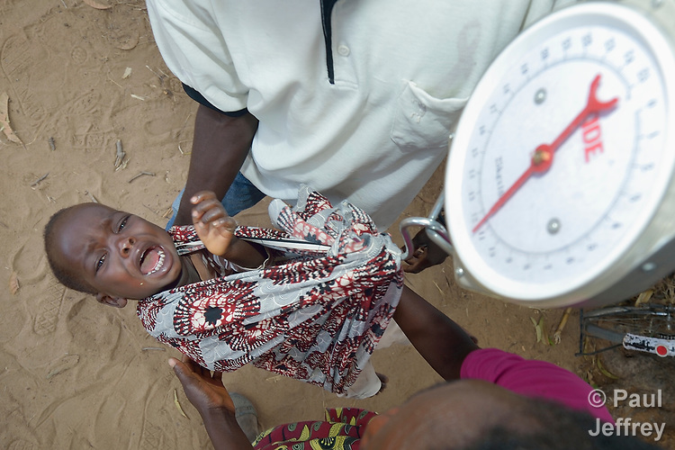 An unhappy baby gets weighed in Kalikumbi, Malawi, where the Maternal, Newborn and Child Health program of the Livingstonia Synod of the Church of Central Africa Presbyterian has helped families stay healthy.
