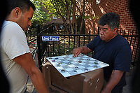 (171006RREI4458) La Esquina where Latinos have gathered for decades at the corner of Mt. Pleasant St. and Kenyon St. NW. to play chekers (damas). El Rana on the right. Washington DC Oct. 6 ,2017 . ©  Rick Reinhard  2017     email   rick@rickreinhard.com