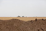 ISIS controlled territory is seen from behind an earthen berm at the front line between Kurdish Zerevani peshmerga and ISIS insurgents outside the strategically important town of Hamdaniya in Iraq.