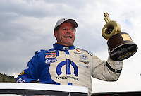 Jul, 22, 2012; Morrison, CO, USA: NHRA pro stock driver Allen Johnson celebrates after winning the Mile High Nationals at Bandimere Speedway. Mandatory Credit: Mark J. Rebilas-US PRESSWIRE
