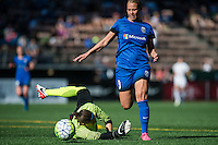 Seattle, WA - Sunday, May 1, 2016: Seattle Reign FC forward Merritt Mathias (9) dribbles past FC Kansas City goalkeeper Nicole Barnhart (18) during a National Women's Soccer League (NWSL) match at Memorial Stadium.