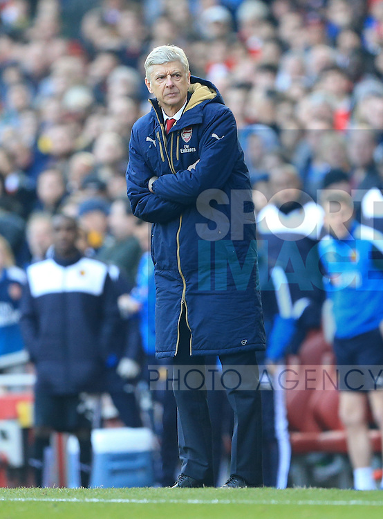 Arsenal's Arsene Wenger looks on dejected during the Emirates FA Cup match at The Emirates Stadium.  Photo credit should read: David Klein/Sportimage