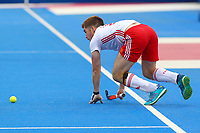 Henry Weir of England keeps the ball in play during the Hockey World League Semi-Final match between England and Netherlands at the Olympic Park, London, England on 24 June 2017. Photo by Steve McCarthy.