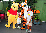 LAKE BUENA VISTA, FL - OCTOBER 01: Young actor / model Jayden & Jonathan poses with Pooh and Tigger while visiting the Cinderella's Castle in the Magic Kingdom during Walt Disney World Resort's 40th Anniversary Celebration at Walt Disney World Resort on October 01, 2011 in Lake Buena Vista, Florida. Walt Disney World opened on October 01, 1971. (Photo by Johnny Louis/jlnphotography.com)