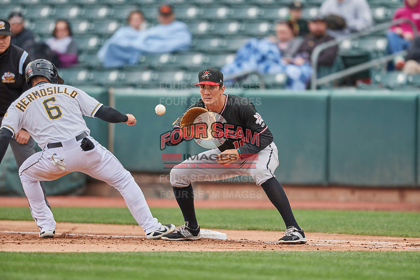 Jordan Patterson (10) of the Albuquerque Isotopes on defense against the Salt Lake Bees at Smith's Ballpark on April 8, 2018 in Salt Lake City, Utah. Albuquerque defeated Salt Lake 11-4. (Stephen Smith/Four Seam Images)