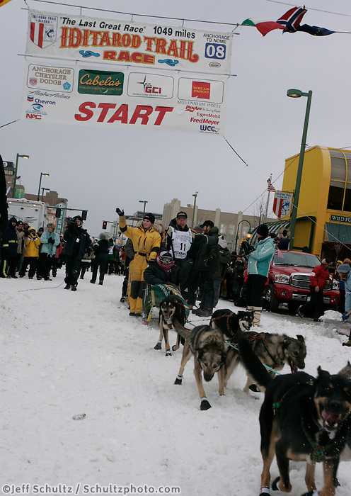 """Jeff King leaves the Anchorage start line with his """"Make-a-Wish"""" Iditarider Elaine Strong, sponsored by Cabelas"""