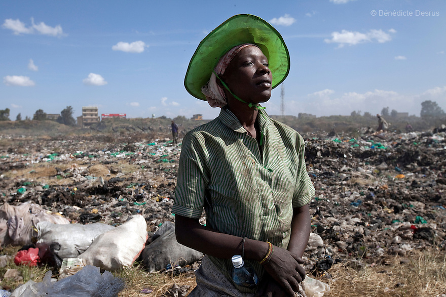 13 february 2013 - Dandora dumpsite, Nairobi, Kenya - A Kenyan woman at the Dandora dumpsite, one of the largest and most toxic in Africa. Located near slums in the east of the Kenyan capital Nairobi, the open dump site was created in 1975 and covers 30 acres. The site receives 2,000 tonnes of unfiltered garbage daily, including hazardous chemical and hospital wastes. It is a source of survival for many people living in the surrounding slums, however it also harms children and adults' health in the area and pollutes the Kenyan capital. Photo credit: Benedicte Desrus