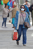 Pictured: A woman wears masks in the city centre of Swansea, south Wales, UK. Friday 20 March 2020<br /> Re: Covid-19 Coronavirus pandemic, UK.