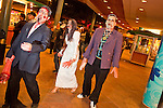 "Oct. 30, 2009 -- PHOENIX, AZ: Zombies walk through a downtown shopping development during the Zombie Walk in Phoenix Friday night. About 200 people participated in the first ""Zombie Walk"" in Phoenix, AZ, Friday night. The Zombies walked through downtown Phoenix ""attacking"" willing victims and mixing with folks going to the theatre and downtown sports venues.  Photo by Jack Kurtz"