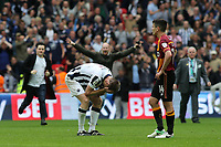 Millwall's Tony Craig puts his head in his hands at the final whistle as the fans run onto the pitch to celebrate during Bradford City vs Millwall, Sky Bet EFL League 1 Play-Off Final at Wembley Stadium on 20th May 2017