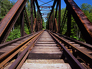 Forth Iron Bridge along the Maine Central Railroad in the White Mountains, New Hampshire USA. This bridge crosses the Sawyer River. And since 1995 the Conway Scenic Railroad, which provides passenger excursion trains has been using the track.