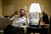United States President Barack Obama talks with Prime Minister Benjamin Netanyahu of Israel during a phone call from his hotel suite in Phnom Penh, Cambodia, November 19, 2012..Mandatory Credit: Pete Souza - White House via CNP