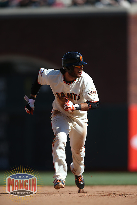 SAN FRANCISCO, CA - APRIL 10:  Brandon Crawford #35 of the San Francisco Giants runs the bases against the Colorado Rockies during the game at AT&T Park on Wednesday, April 10, 2013 in San Francisco, California. Photo by Brad Mangin