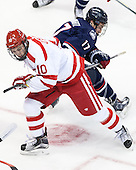 Danny O'Regan (BU - 10), Jesse Schwartz (UConn - 17) - The Boston University Terriers defeated the visiting University of Connecticut Huskies 4-2 (EN) on Saturday, October 24, 2015, at Agganis Arena in Boston, Massachusetts.