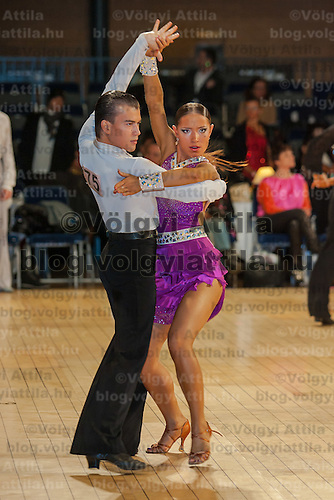 Vadim Ivanov and Ekaterina Tsybrova from Portugal perform their dance during the amateur rising stars latin-american competition of the  United Kingdom Open Dance Championships held in Bournemouth International Centre, Bournemouth, United Kingdom. Tuesday, 19. January 2010. ATTILA VOLGYI
