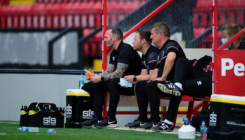 Lincoln City manager Michael Appleton, left, `Richard O'Donnell, centre, and David Kerslake in the dugout<br /> <br /> Photographer Andrew Vaughan/CameraSport<br /> <br /> The EFL Sky Bet League One - Saturday 12th September  2020 - Lincoln City v Oxford United - LNER Stadium - Lincoln<br /> <br /> World Copyright © 2020 CameraSport. All rights reserved. 43 Linden Ave. Countesthorpe. Leicester. England. LE8 5PG - Tel: +44 (0) 116 277 4147 - admin@camerasport.com - www.camerasport.com - Lincoln City v Oxford United
