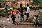 Local tourist photographers wait outside the popular Ajanta Caves complex.