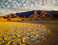Dried mud pattern dunes, and Paniment Mountains. Death Valley National Park, California