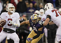 Benning Potoa'e pursues the Stanford quarterback.