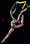 Rhythmic ribbon gymnast Youlia Rasksina performs during the Sydney 2000 Olympics Gymnastics Gala at the Super Dome in Sydney, Australia, Tuesday Sept. 26, 2000. The gala featured gold medalist and renowned gymnasts from various gymnastic disciplines. (AP Photo/ Victoria Arocho)