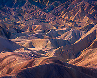 The characteristic sandstone patterns of Death Valley are transformed into a colorful array by the early morning light.