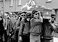 Funeral of UDA member Michael Wilson who was shot by gunmen on 19th June 1973. Michael Wilson lived in the home of his brother-in-law UDA Vice Chairman, Tommy Herron. Herron is married to Wilson's sister. Fellow UDA members carry the Union Jack draped coffin of their assasinated colleague. Rev Ian Paisley, extreme left with clerical collar, attended the funderal and gave a 15 minute oration. For more information re this killing go page 368 of Lost Lives, a detailed listing of deaths during the N Ireland Troubles. Photo includes UDA leader Tommy Herron (extreme left, looking down, fair hair, receeding hairline). 197306190449c.<br /> <br /> Copyright Image from Victor Patterson,<br /> 54 Dorchester Park, <br /> Belfast, UK, BT9 6RJ<br /> <br /> t1: +44 28 9066 1296 (from Rep of Ireland 048 9066 1296)<br /> t2: +44 28 9002 2446 (from Rep of Ireland 048 9002 2446)<br /> <br /> m: +44 7802 353836<br /> <br /> e: victorpatterson@me.com<br /> www.victorpatterson.com<br /> <br /> Please see my Terms and Conditions of Use at www.victorpatterson.com. It is IMPORTANT that you familiarise yourself with them.<br /> <br /> Images used on the Internet must be visibly watermarked i.e. © Victor Patterson<br /> within the body of the image and copyright metadata must not be deleted. Images <br /> used on the Internet have a size restriction of 4kbs and will be chargeable at current<br />  NUJ rates unless agreed otherwise.<br /> <br /> This image is only available for the use of the download recipient i.e. television station, newspaper, magazine, book publisher, etc, and must not be passed on to any third <br /> party. It is also downloaded on condition that each and every usage is notified within 7 days to victorpatterson@me.com<br /> <br /> The right of Victor Patterson to be identified as the author is asserted in accordance with The Copyright Designs And Patents Act (1988). All moral rights are asserted.