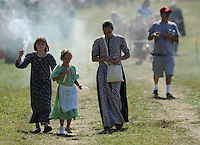 NWA Democrat-Gazette/ANDY SHUPE<br /> Re-enactors walk Saturday, Sept. 26, 2015, while participating in a re-enactment of the Civil War Battle of Pea Ridge in Pea Ridge. Visit nwadg.com/photos to see more from the weekend.