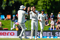 Trent Boult of the Black Caps celebrates the wicket of Alastair Cook of England with team mate during Day 3 of the Second International Cricket Test match, New Zealand V England, Hagley Oval, Christchurch, New Zealand, 1st April 2018.Copyright photo: John Davidson / www.photosport.nz