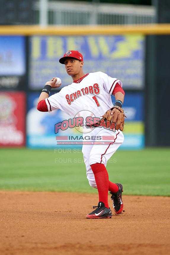 Harrisburg Senators second baseman Chris Bostick (1) throws to first base during a game against the New Hampshire Fisher Cats on June 2, 2016 at FNB Field in Harrisburg, Pennsylvania.  New Hampshire defeated Harrisburg 2-1.  (Mike Janes/Four Seam Images)