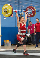 23 FEB 2014 - SMETHWICK, GBR - Sarah Davies (ENG / GBR) of Great Britain and England, a former Miss England contestant, attempts to complete a lift during the women's 63kg category round at the 2014 English Weightlifting Championships at the Harry Mitchell Leisure Centre in Smethwick, Great Britain. Davies'  final total of 190kg makes her eligible for selection for the England weightlifting team for the 2014 Commonwealth Games  (PHOTO COPYRIGHT © 2014 NIGEL FARROW, ALL RIGHTS RESERVED)