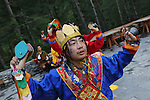 A traditional male dance group performs in the courtyard of the Amankora hotel, Thimpu..Bhutan the country that prides itself on the development of 'Gross National Happiness' rather than GNP. This attitude pervades education, government, proclamations by royalty and politicians alike, and in the daily life of Bhutanese people. Strong adherence and respect for a royal family and Buddhism, mean the people generally follow what they are told and taught. There are of course contradictions between the modern and tradional world more often seen in urban rather than rural contexts. Phallic images of huge penises adorn the traditional homes, surrounded by animal spirits; Gross National Penis. Slow development, and fending off the modern world, television only introduced ten years ago, the lack of intrusive tourism, as tourists need to pay a daily minimum entry of $250, ecotourism for the rich, leaves a relatively unworldly populace, but with very high literacy, good health service and payments to peasants to not kill wild animals, or misuse forest, enables sustainable development and protects the country's natural heritage. Whilst various hydro-electric schemes, cash crops including apples, pull in import revenue, and Bhutan is helped with aid from the international community. Its population is only a meagre 700,000. Indian and Nepalese workers carry out the menial road and construction work.
