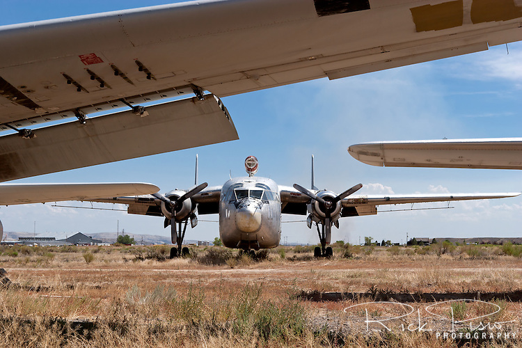 A C-119 Flying Boxcar in sprayer configuration sits in the Greybull, Wyoming, storage area awaiting a new owner or the scrappers torch prior to auction in August of 2006.<br /> <br /> <br /> Hawkins and Powers was founded in 1969 by Dan Hawkins and Gene Powers. H&amp;P shut their doors at the end of 2005 and auctioned off their assets to satisfy nearly $15 million that it owed to creditors.