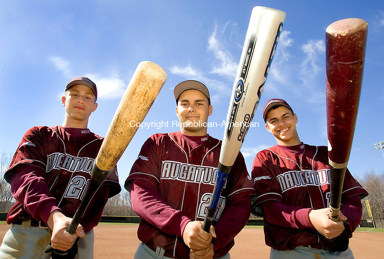 WOODBURY, CT--19 APRIL 2007--041907JS12-Naugatuck High School baseball players, from left, Xavier Ortiz, Brett Kwaak and Chris Cretella display the three types of bats being used in local high school baseball. Ortiz is holding a composite Metal/Wood bat, Kwaak shows a traditional Stealth aluminum bat and Cretella shows off a wood bat.  <br /> Jim Shannon / Republican-American