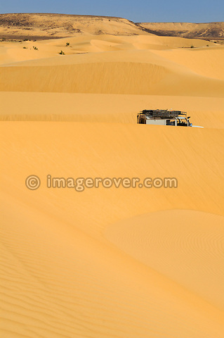 Africa, Mauritania, Sahara Desert, nr. Chinguetti. Land Rover Defender TD5 Station Wagon crossing sand dunes between Chinguetti and Tidjikdja. --- RELEASES AVAILABLE! Automotive trademarks are the property of the trademark holder, authorization may be needed for some uses.