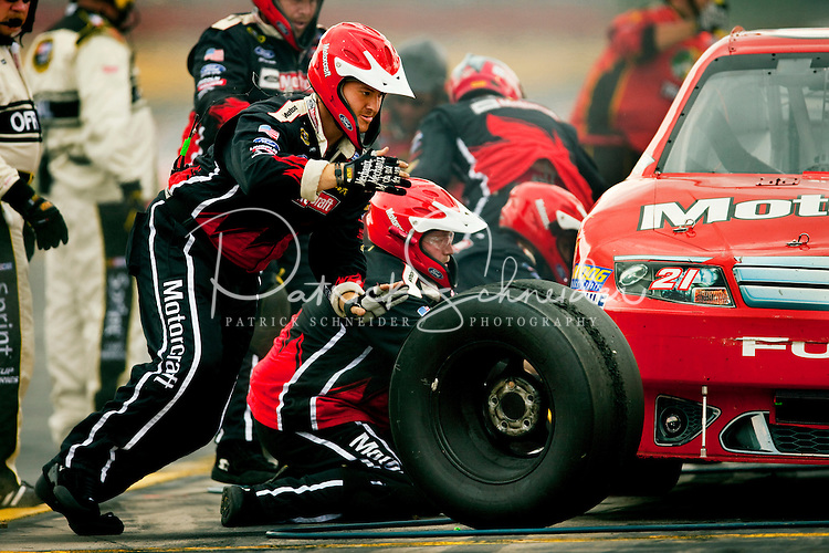 The pit crew for the No. 21 Motorcraft Ford hustle during a pit stop during the 2009 Coca-Cola Classic 600 race at the Lowe's Motor Speedway, in Concord, NC. NASCAR Driver David Reutimann ultimately won the race, and his first Sprint Cup, during the rain-shortened event, held May 25, 2009. NASCAR's longest scheduled race went only 227 laps, or 340.5 miles, before officials ended it because of rain. The 2009 race was the 50th running of the Coca-Cola 600. Ryan Newman and Robby Gordon finished second and third respectively.